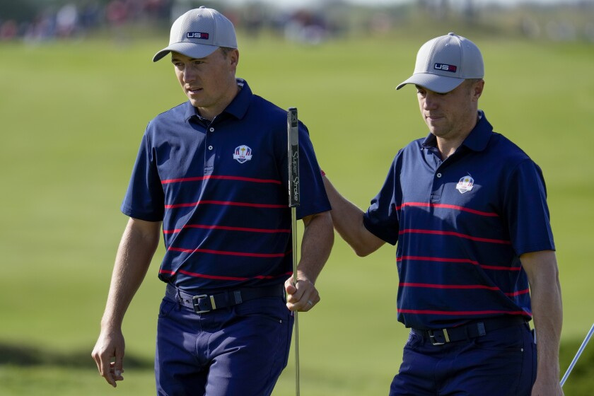 Team USA's Justin Thomas pats Team USA's Jordan Spieth on the back after putting during a foursome match the Ryder Cup at the Whistling Straits Golf Course Friday, Sept. 24, 2021, in Sheboygan, Wis. (AP Photo/Ashley Landis)