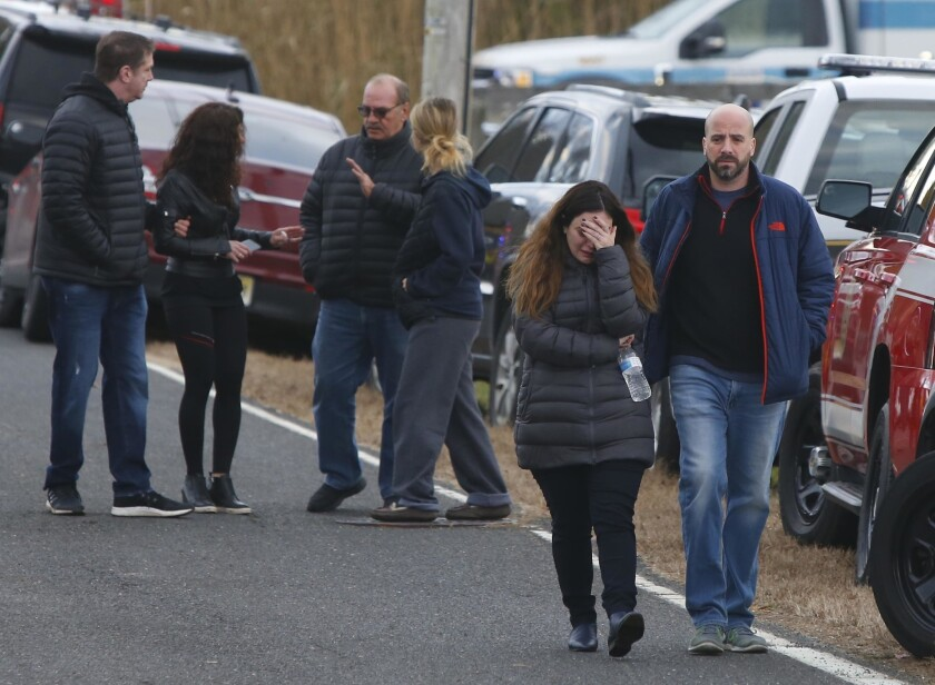 Pedestrians walk away from the scene of a fatal at 15 Willow Brook Rd. Tuesday, Nov. 20, 2018, in Co