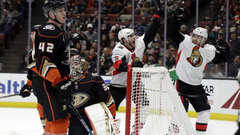 Ottawa Senators' Bobby Ryan, center, celebrates his goal with teammate Chris Tierney, right, during the third period against the Ducks on Wednesday.
