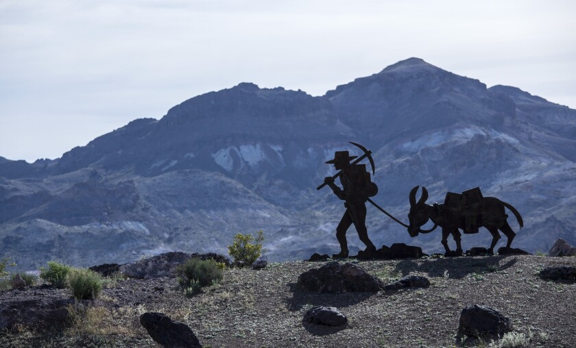 A sculpture of a prospector marks a boundary of Death Valley National Park.