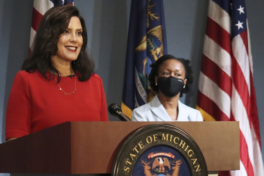 In this photo provided by the Michigan Office of the Governor, Gov. Gretchen Whitmer addresses the state during a speech in Lansing, Mich., Wednesday, Sept. 16, 2020. Whitmer said Wednesday, it practically does not make sense for Michigan to enforce coronavirus restrictions at President Donald Trump's reelection campaign rallies while also pointing to First Amendment freedoms. The Democratic governor has expressed safety concerns with several thousand attending a Trump rally in the Saginaw area last week, calling it a potential COVID-19 superspreader event. (Michigan Office of the Governor via AP)
