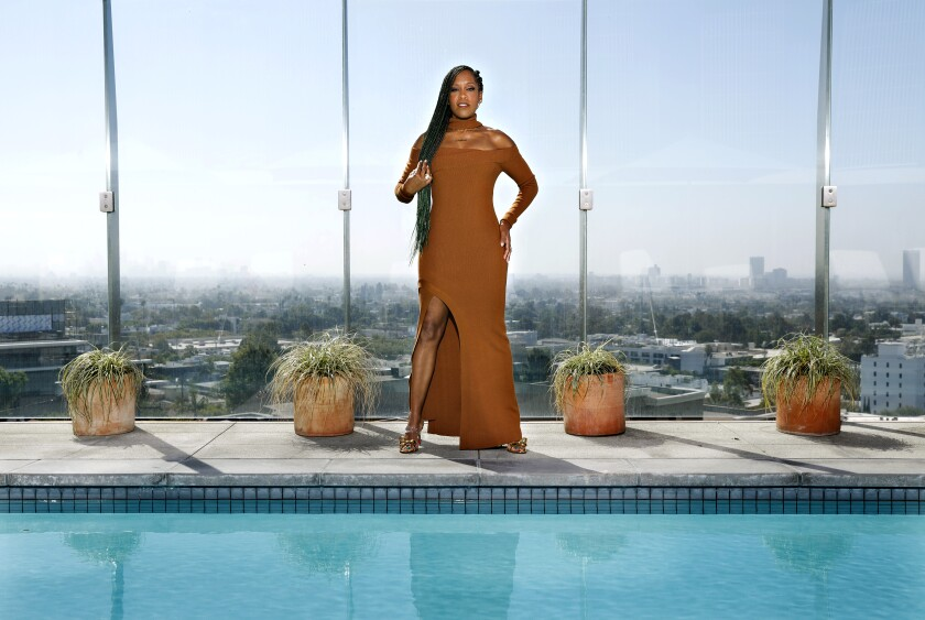 Regina King poses by a pool in West Hollywood.