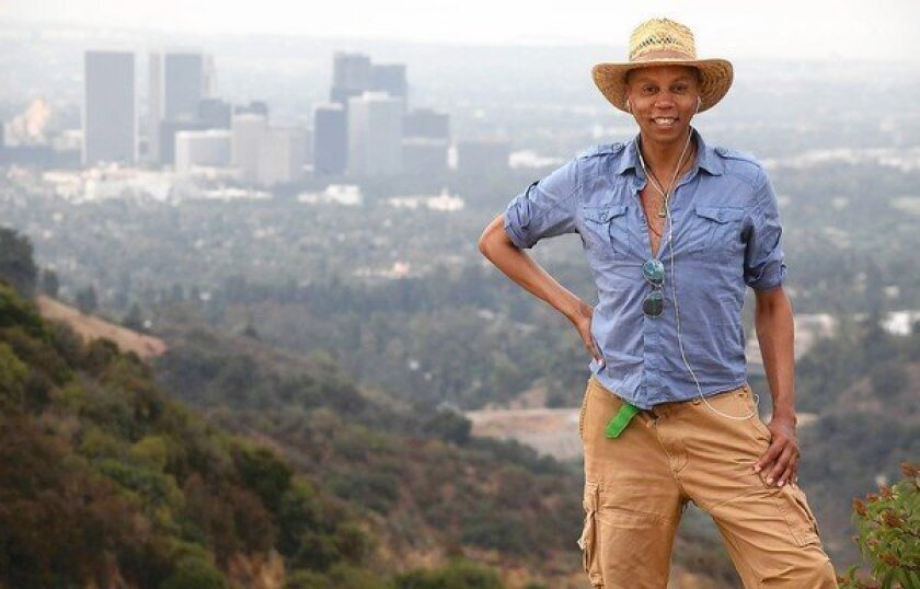 RuPaul takes a short break during hiking in Franklin Canyon Park in Los Angeles.