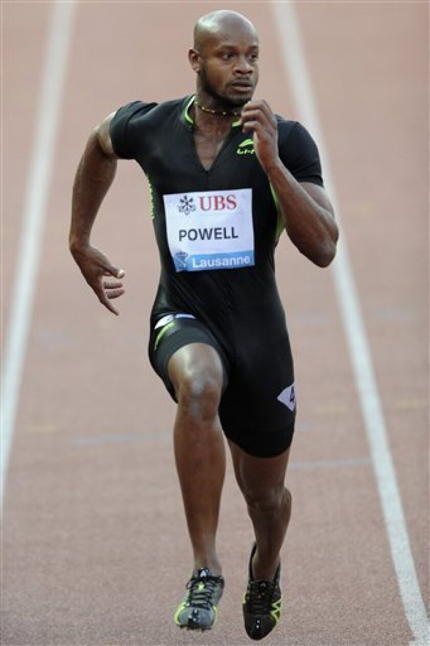 Asafa Powell, from Jamaica, in action during the men's 100m race, at the Athletissima IAAF Diamond League international athletics meeting in the Stade Olympique de la Pontaise in Lausanne, Switzerland, on Thursday June 30, 2011.(AP Photo/Keystone, Samuel Truempy) GERMANY AND AUSTRIA OUT