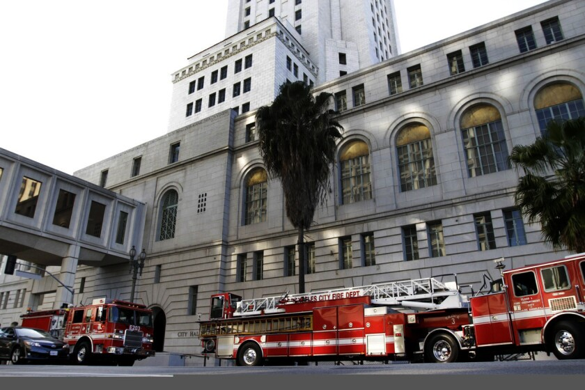 Los Angeles fire units respond to a flood at City Hall last year. Overtime pay climbed for city firefighters in 2013.