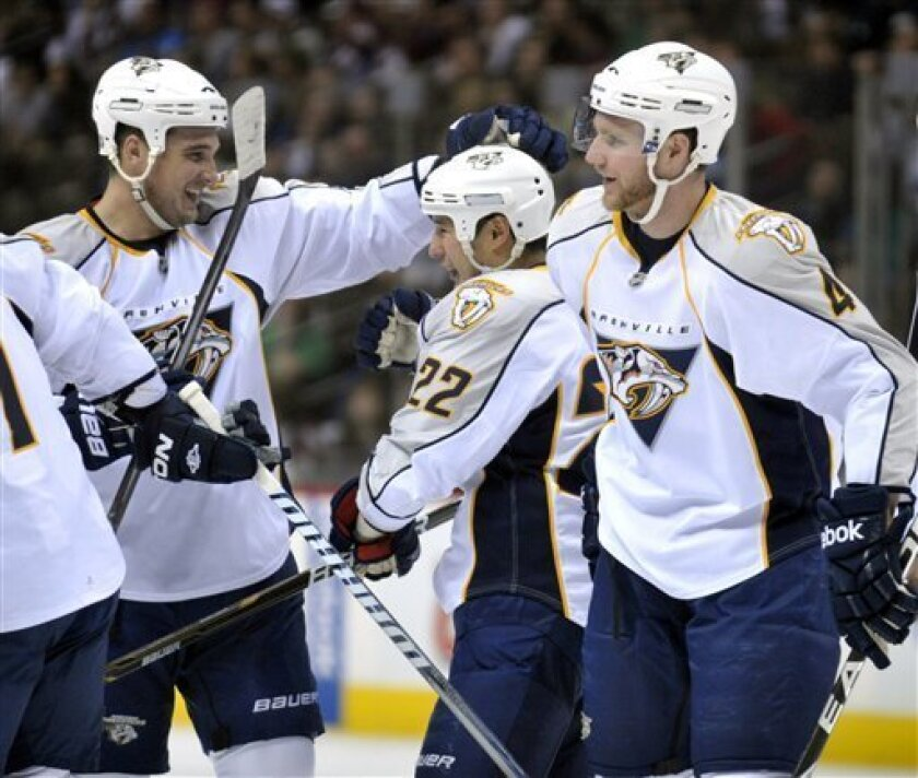 Nashville Predators defenseman Shane O'Brien, left, congratulates right wing Jordin Tootoo (22) after Tootoo scored a goal in the second period of their NHL hockey game  against the Colorado Avalance in Denver on Thursday, March 31, 2011. Predators defenseman Cody Franson (4) skates past. (AP Photo