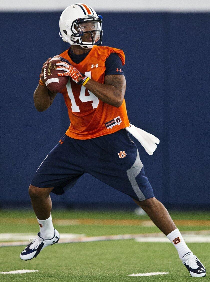 Auburn quarterback Nick Marshall sets to throw during NCAA college football practice Friday, Aug. 1, 2014, in Auburn, Ala. (AP Photo/Brynn Anderson)