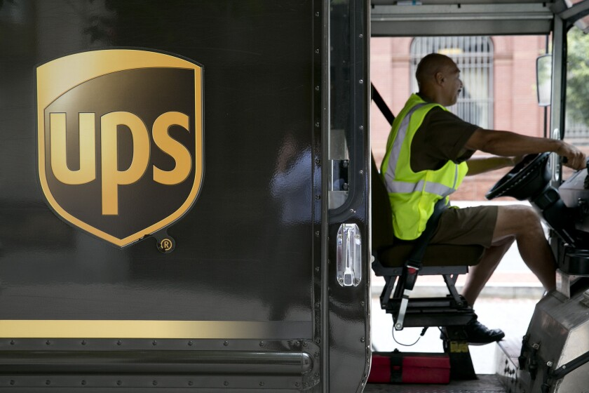 UPS driver hard at work on a Washington,. D.C., route: Is the company getting a sweet deal from Congress on its pension obligations?