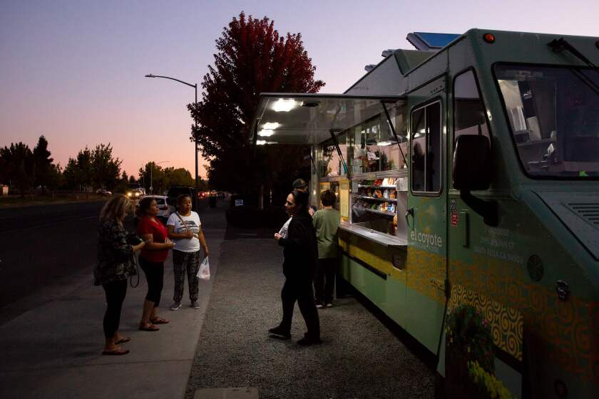 Residents pick up meals from a food truck during power outages in the Sonoma area