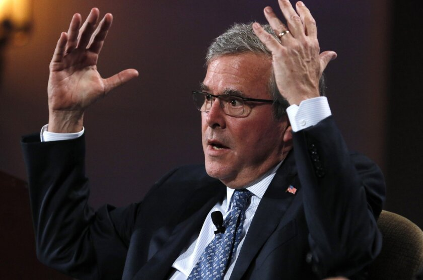 Former Florida Gov. Jeb Bush answers a question earlier this week at the Club for Growth's conference in Palm Beach, Fla. On Friday, he addressed the Conservative Political Action Conference.
