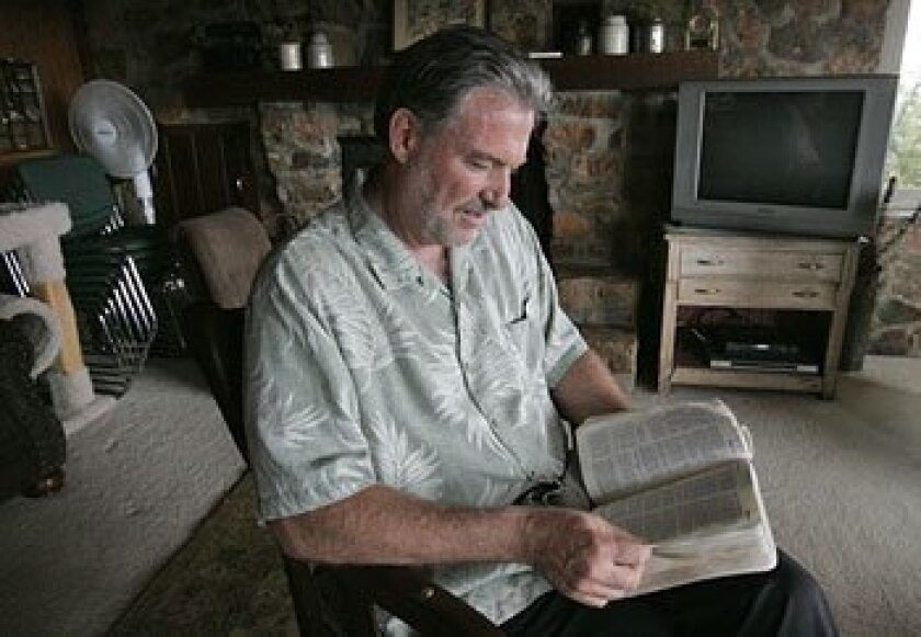 David Jones, a pastor in National City, holds Bible  study groups in his Bonita home. (Peggy Peattie / Union-Tribune)