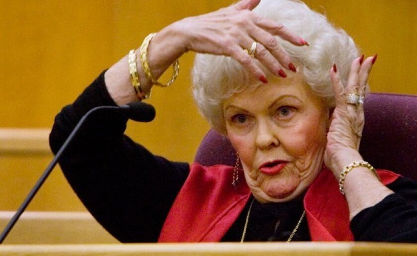 Natalie Herbst-Vinge, 76, of La Mesa, describes how her face and head were wrapped with duct tape during her abduction on Dec. 8, 2008. Jeffrey Edward Nelson is on trial for Herbst-Vinge's attempted murder and torture. (Howard Lipin / Union-Tribune)