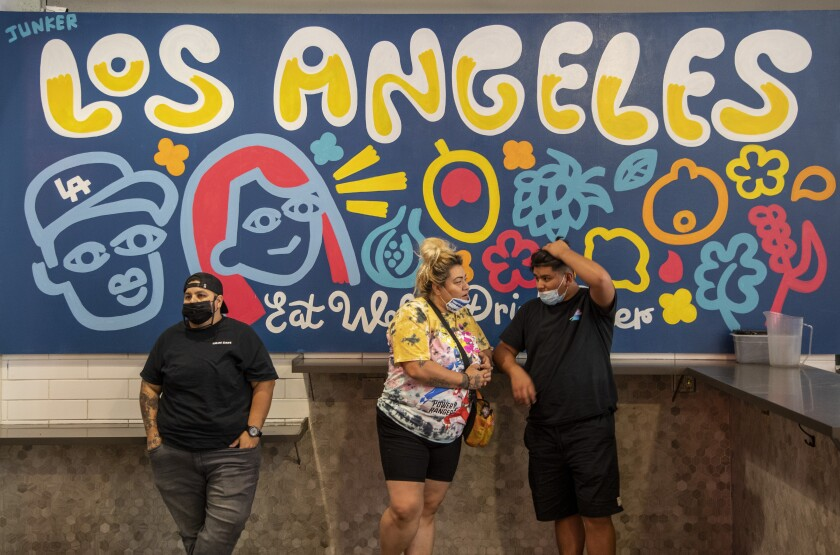Visitors to the Grand Central Market in Los Angeles on July 27 are both masked and unmasked.