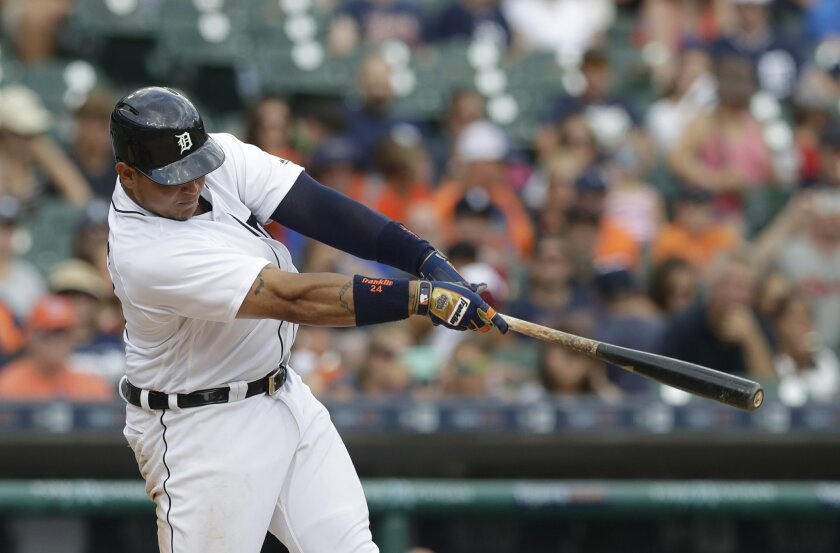 Detroit Tigers' Miguel Cabrera hits a two-run home run during the seventh inning of a baseball game against the Houston Astros, Sunday, July 31, 2016, in Detroit. (AP Photo/Carlos Osorio)