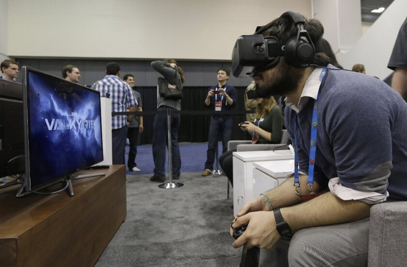 A man tries the Oculus virtual reality headset at Game Developers Conference