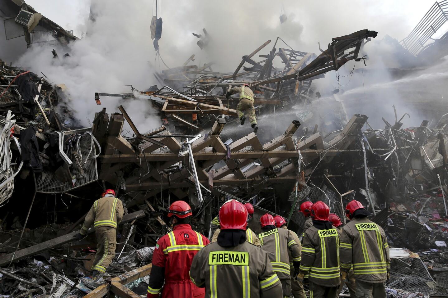Burning Tehran high-rise collapses