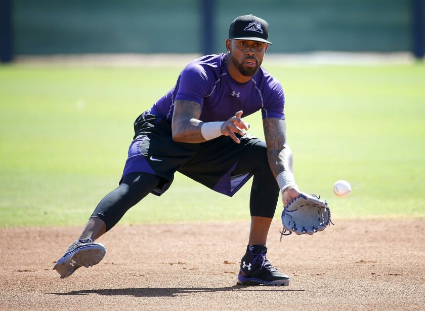 FILE - In this May 19, 2016, file photo, Colorado Rockies' Jose Reyes runs drills during an extended spring training at the Rockies' facility in Scottsdale, Ariz. Rockies manager Walt Weiss says Reyes will report to Triple-A Albuquerque for an injury rehabilitation assignment on Wednesday, June 1,