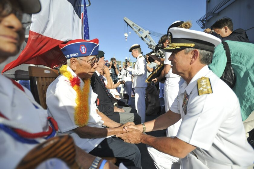 Adm. Harry Harris Jr., commander of U.S. Pacific Fleet, thanks Ralph Tomei, a 442nd Regimental Combat Team veteran, for his contributions during World War II.  Tomei represented his friend Shiro Aoki during presentation of the French Legion of Honor medal aboard the French frigate Prairial.