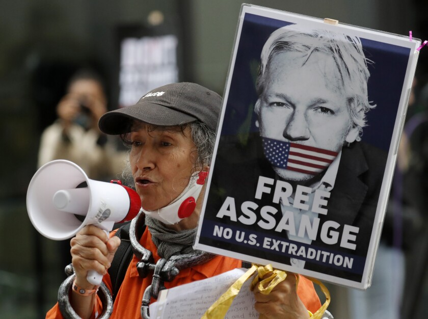 Julian Assange supporters protest outside the Old Bailey in London, Monday, Sept. 7, 2020. Lawyers for WikiLeaks founder Julian Assange and the U.S. government were squaring off in a London court on Monday at a high-stakes extradition case delayed by the coronavirus pandemic. American prosecutors have indicted the 49-year-old Australian on 18 espionage and computer misuse charges over the WikiLeaks publication of secret U.S. military documents a decade ago. The charges carry a maximum sentence of 175 years in prison. (AP Photo/Frank Augstein)