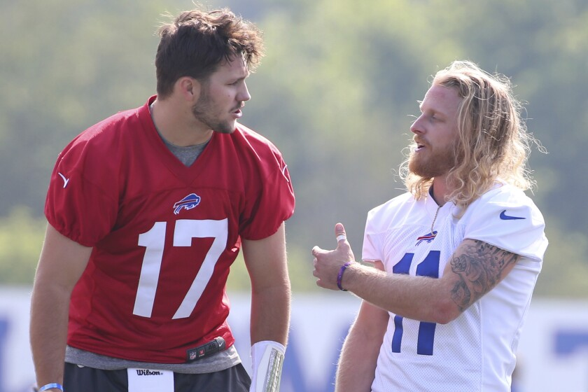 Buffalo Bills quarterback Josh Allen (17) and receiver Cole Beasley (11) talk during NFL football training camp in Orchard Park, N.Y., Wednesday, July 28, 2021. (AP Photo/Jeffrey T. Barnes)