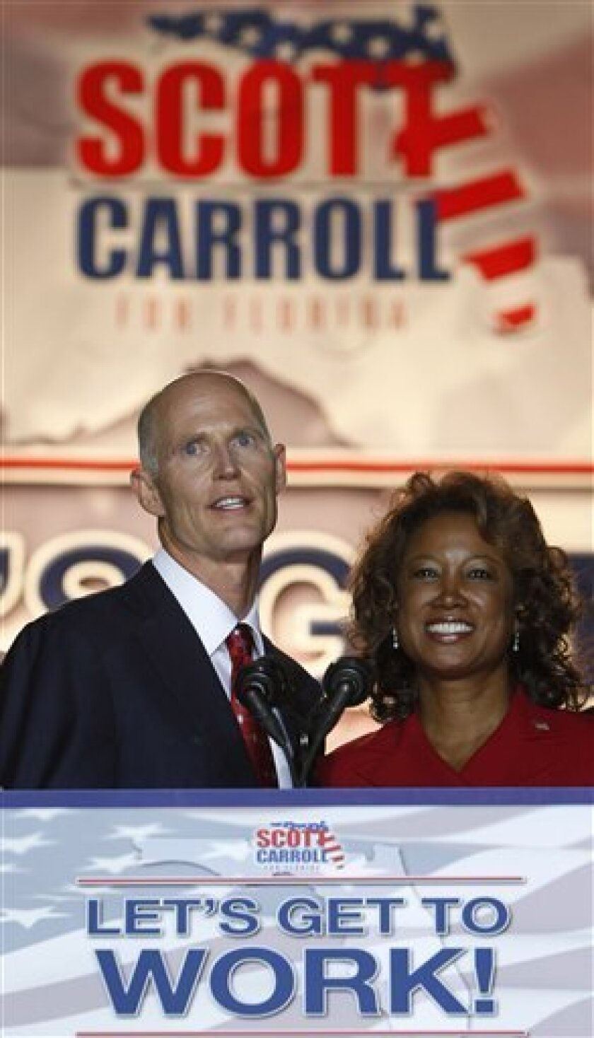 Florida Republican gubernatorial candidate Rick Scott, left, and his running mate Florida Rep. Jennifer Carroll, R-Jacksonville, thank supporters in the early morning hours of Wednesday, Nov. 3, 2010 in Fort Lauderdale, Fla. (AP Photo/Wilfredo Lee)