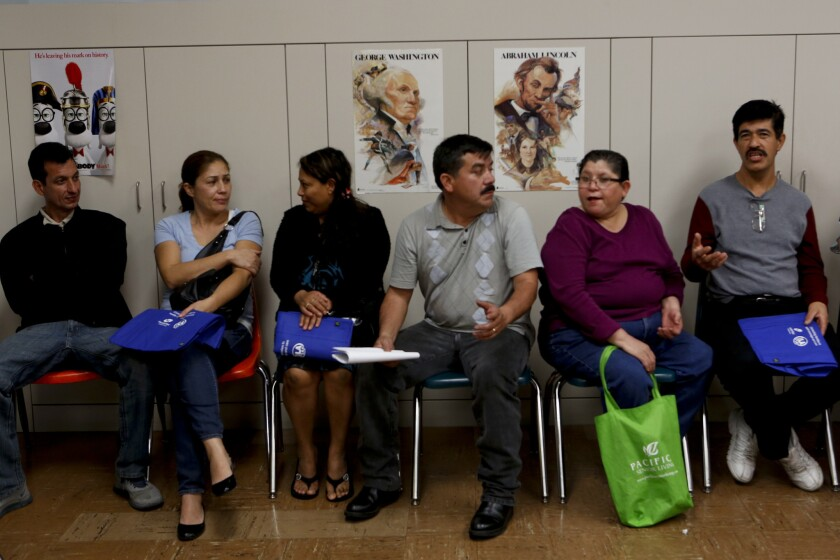 Californians wait to see if they qualify for public healthcare at an event in Los Angeles. A U.S. Supreme Court ruling on Tuesday has curtailed lawsuits from doctors who say Medicaid rates are too low.