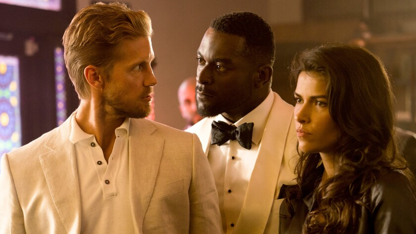 "Matt Barr, left, Michael James Shaw and Sofia Pernas in ""Blood & Treasure"" on CBS."