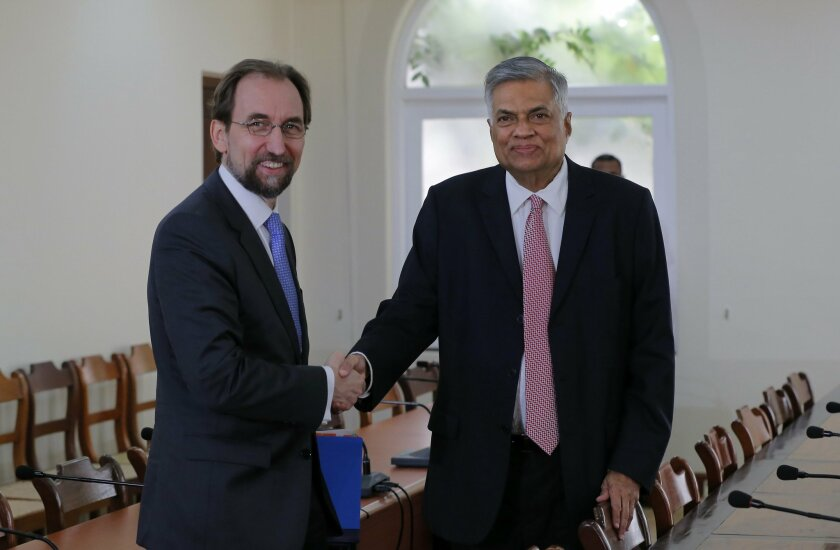 Sri Lankan Prime Minister Ranil Wickremesinghe, right, shakes hands with U.N. High Commissioner for Human Rights Zeid Raad al-Hussein before their meeting in Colombo, Sri Lanka, Tuesday, Feb. 9, 2016. The top U.N. human rights official is visiting Sri Lanka to review measures taken by the island-na