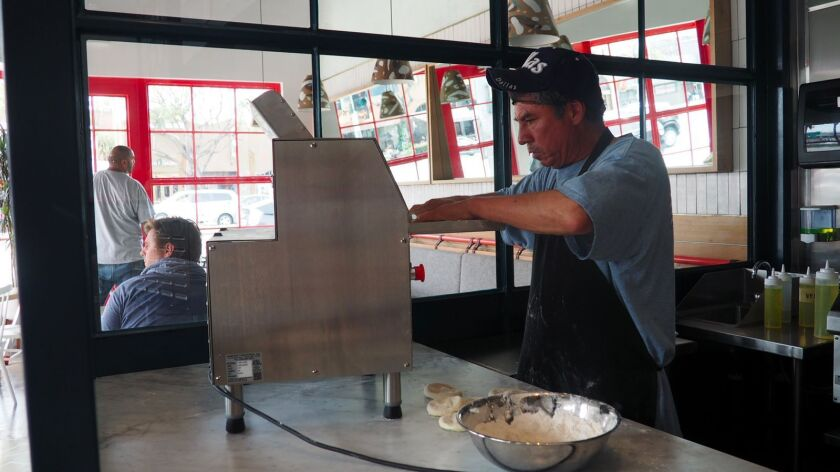 A Bäcoshop employee prepares dough for the bäcos, the flatbreads used to make sandwiches and wraps at the new Culver City restaurant.