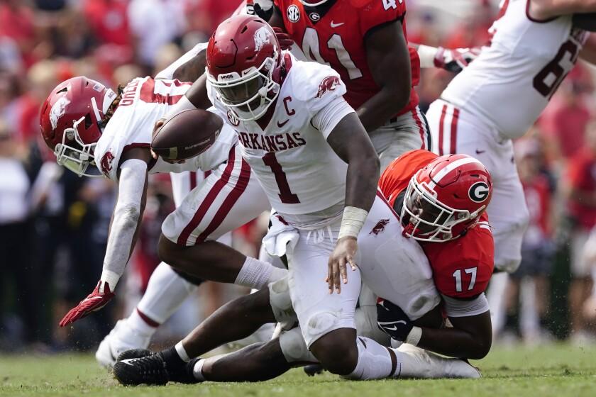 Arkansas quarterback KJ Jefferson (1) is sacked by Georgia linebacker Nakobe Dean (17) during the second half of an NCAA college football game Saturday, Oct. 2, 2021, in Athens, Ga. (AP Photo/John Bazemore)
