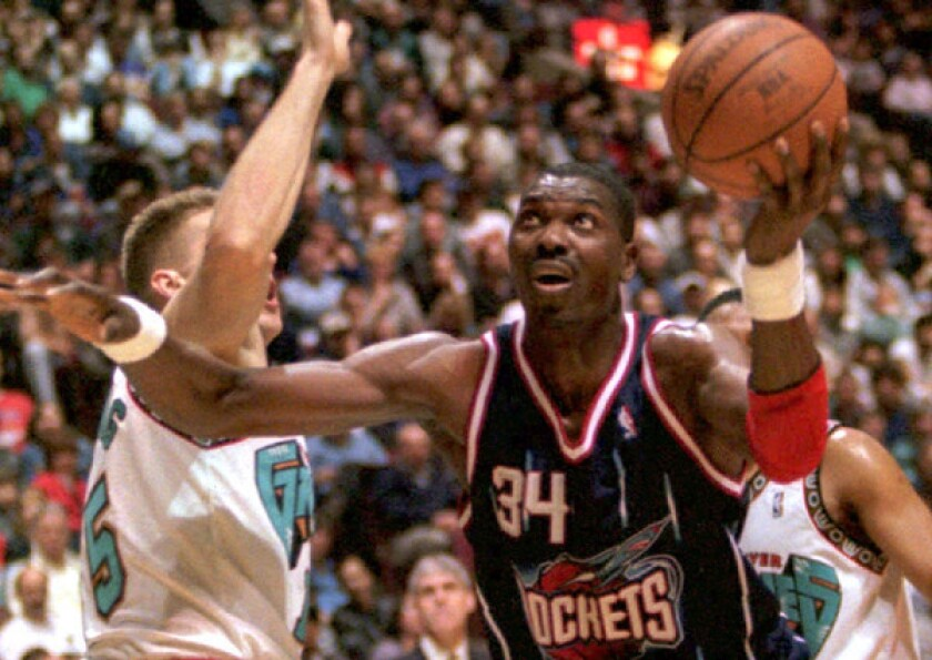 """Hakeem Olajuwon, who scored 26,946 points in his career, ninth on the NBA's all-time scoring list, says he expects Dwight Howard to stay with the Lakers. """"He loves L.A.,"""" Olajuwon said."""