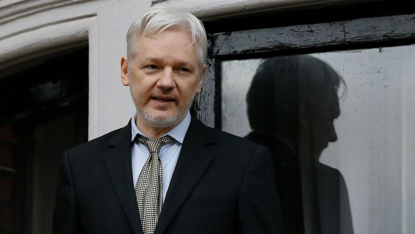 WikiLeaks founder Julian Assange speaks in 2016 from the balcony of the Ecuadorean Embassy in London, where he has been holed up since jumping bail in 2012.