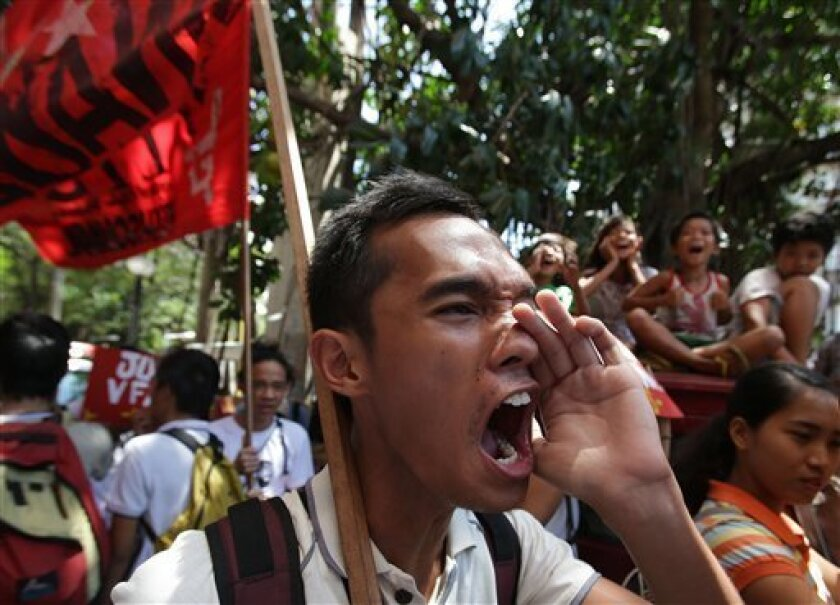 A Filipino protester shouts slogans as they march near the U.S. embassy during a rally to oppose the planned visit of U.S. President Barack Obama in Manila, Philippines on Wednesday Oct. 2, 2013. Obama has canceled two stops, Malaysia and Philippines, on his long-planned trip to Asia because of the