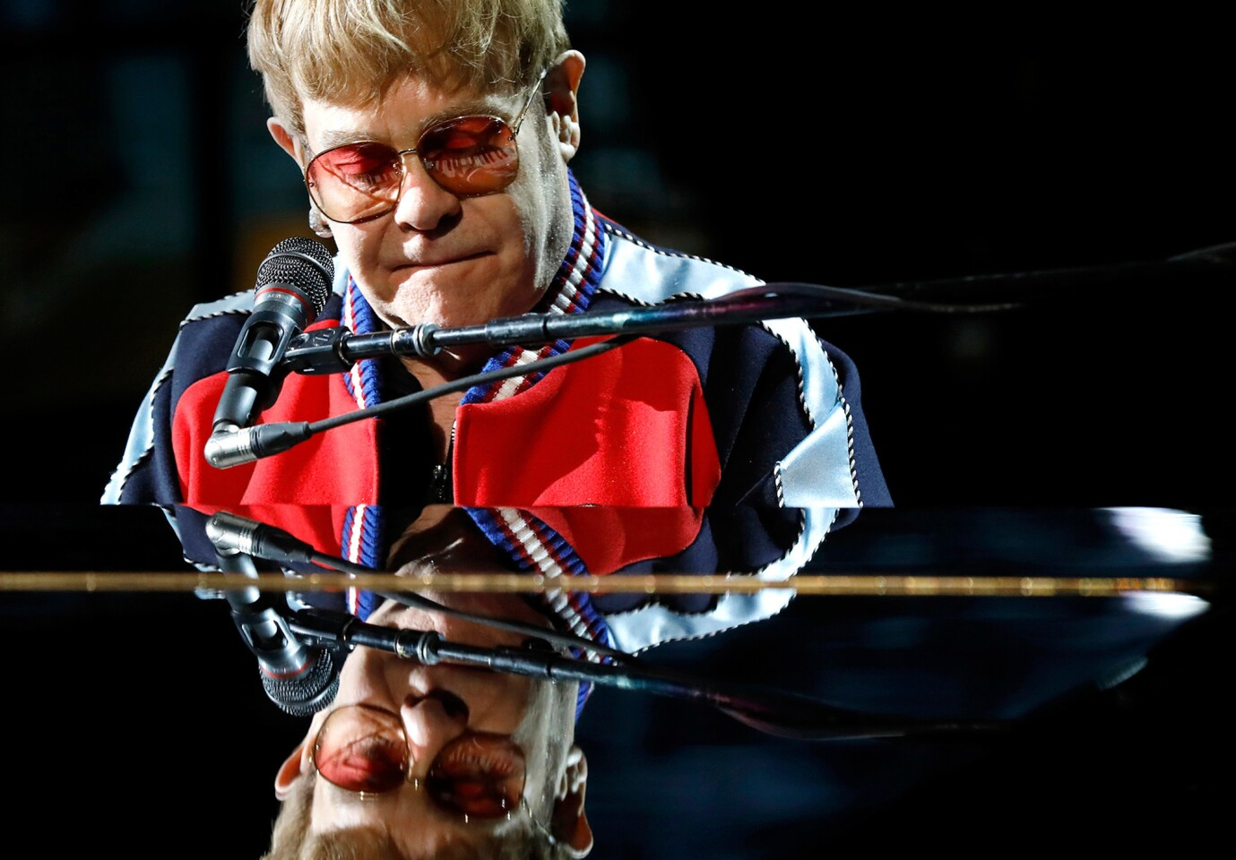 Elton John rehearses for the 60th Grammy Awards show at Madison Square Garden in New York on Jan. 25. Note the keyboard eyelashes.