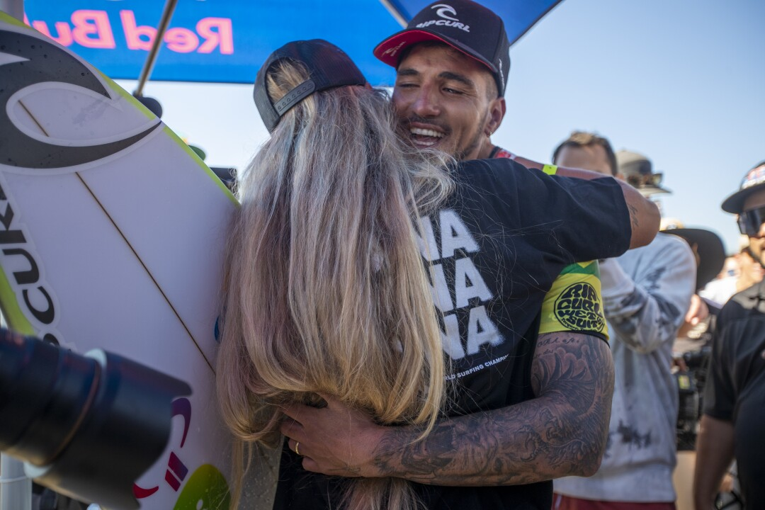 Gabriel Medina tears up as he hugs his wife, Yasmin Brunet, after winning his third World Surf League Championship Title