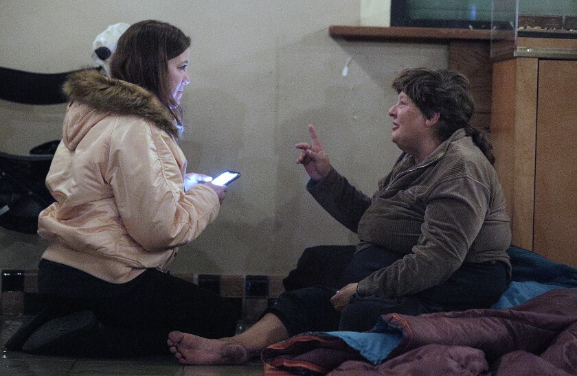 Sara Lerma interviewing Velda Batton for the annual Glendale homeless count on Wedneday, Jan. 22. Volunteers like Lerma spent the night traveling across the city talking to people like Batton in order to get an idea of how many unsheltered people are living in Glendale.