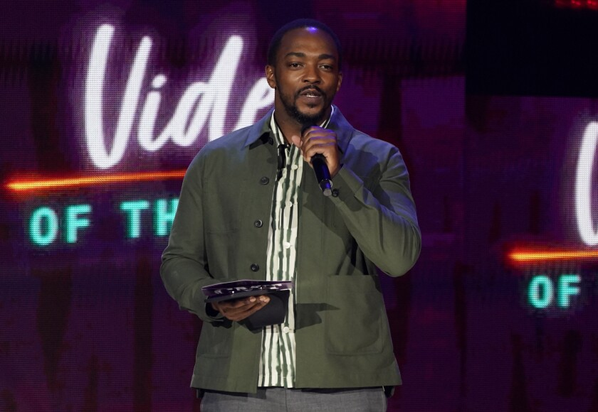 Anthony Mackie presents the award for video of the year at the CMT Music Awards at the Bridgestone Arena on Wednesday, June 9, 2021, in Nashville, Tenn. (AP Photo/Mark Humphrey)
