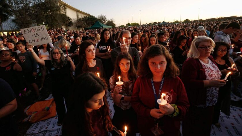 Thousands attend a vigil after 17 people were shot to death at Marjory Stoneman Douglas High in Parkland, Fla.