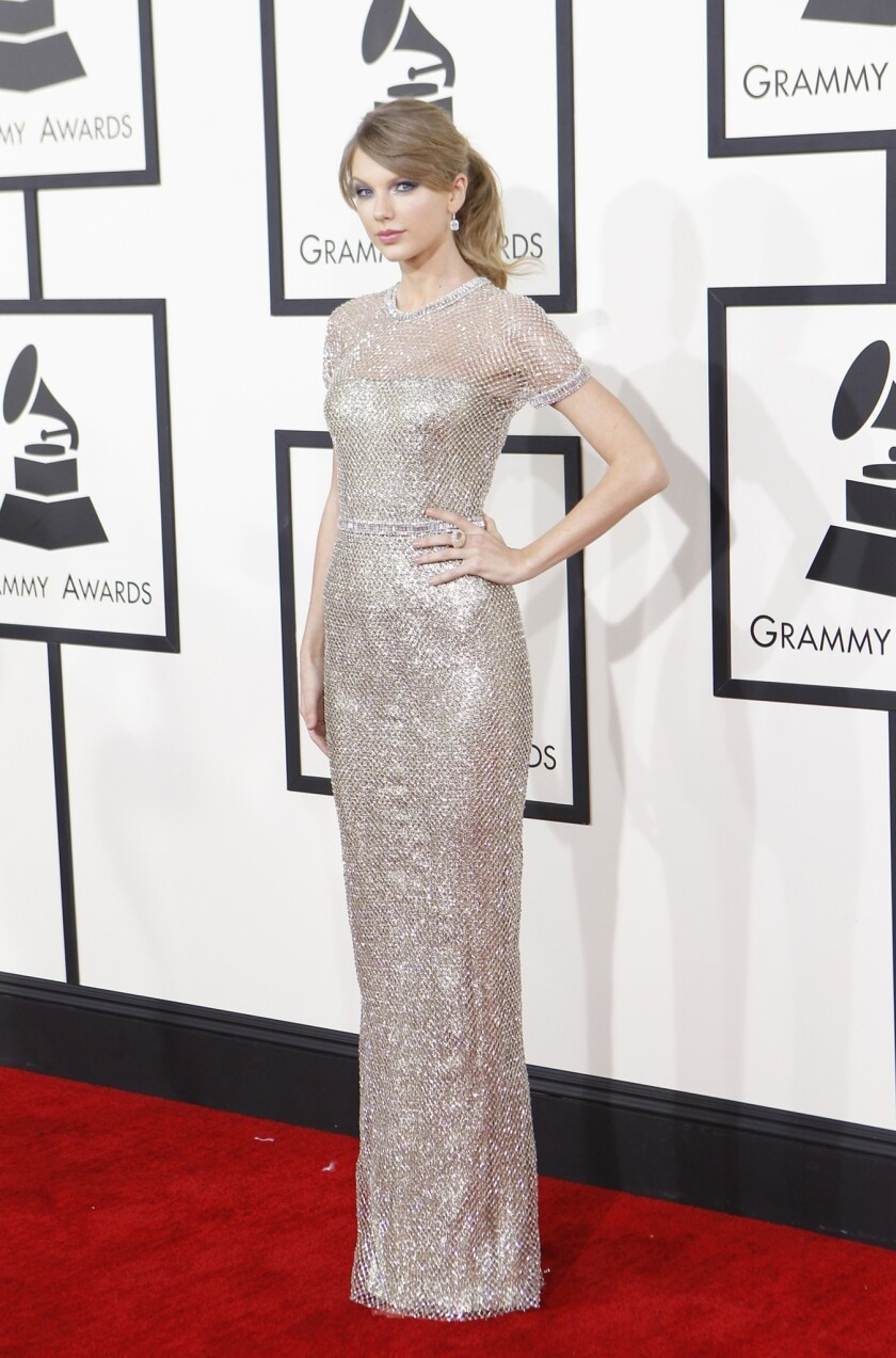 Taylor Swift arrives at the 56th Grammy Awards.