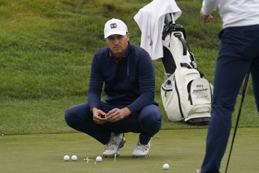 Jordan Spieth watches from the putting green during practice for the PGA Championship golf tournament at TPC Harding Park in San Francisco, Tuesday, Aug. 4, 2020. (AP Photo/Jeff Chiu)