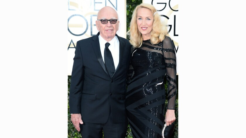 Rupert Murdoch, 84, and Jerry Hall, 59, arrive Sunday at the Golden Globe Awards at the Beverly Hilton Hotel.