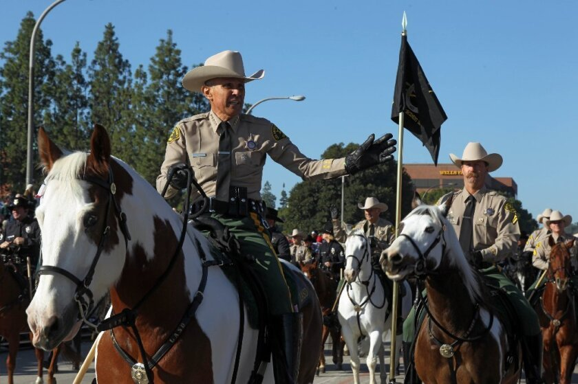 Los Angeles County Sheriff Lee Baca rides along Colorado Boulevard during the 125th Rose Parade on Wednesday.