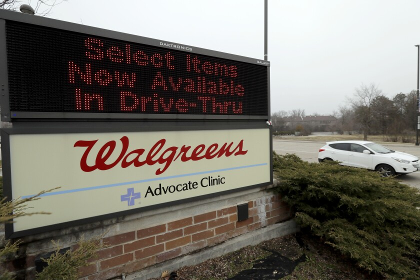 """A Walgreens reader board advertises """"Select items now available in drive-thru."""""""