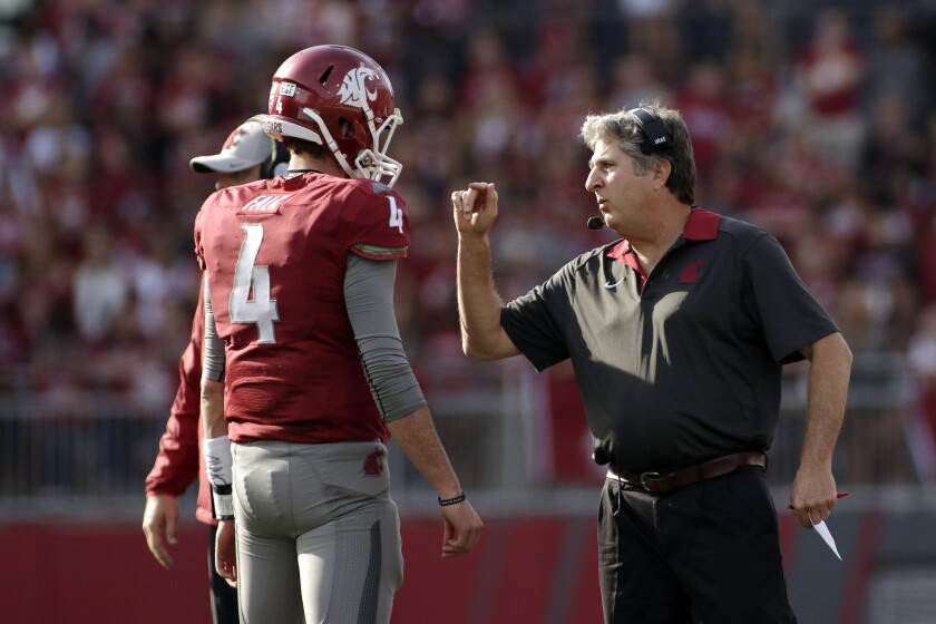 Washington State Coach Mike Leach, right, and quarterback Luke Falk (4) quietly have led the Cougars to a 6-3 record.