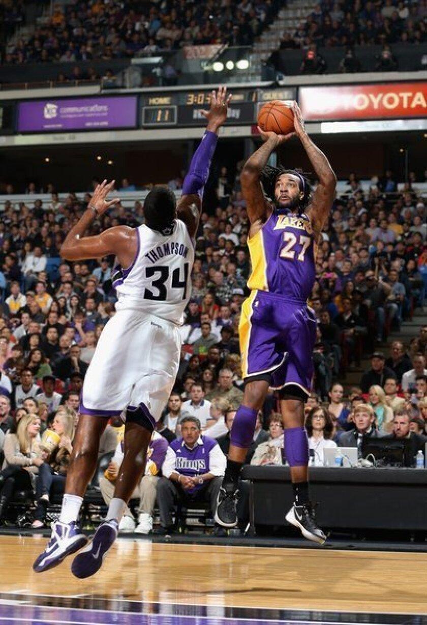 The Lakers' Jordan Hill shoots over the Sacramento Kings' Jason Thompson.