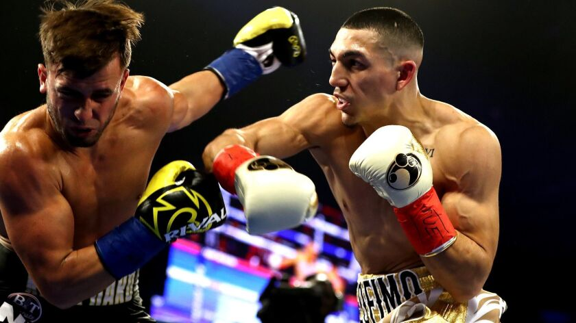 Teofimo Lopez, right, knocks out Mason Menard in the first round during their lightweight fight at Hulu Theater at Madison Square Garden on Dec. 8, 2018.