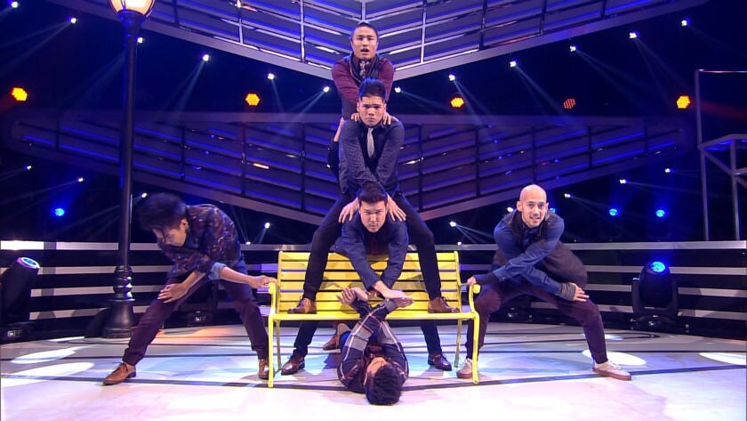 """Ultimate dance crew champion Quest Crew creates a formation on stage during an emotional performance on """"America's Best Dance Crew: Road to the VMAs."""""""