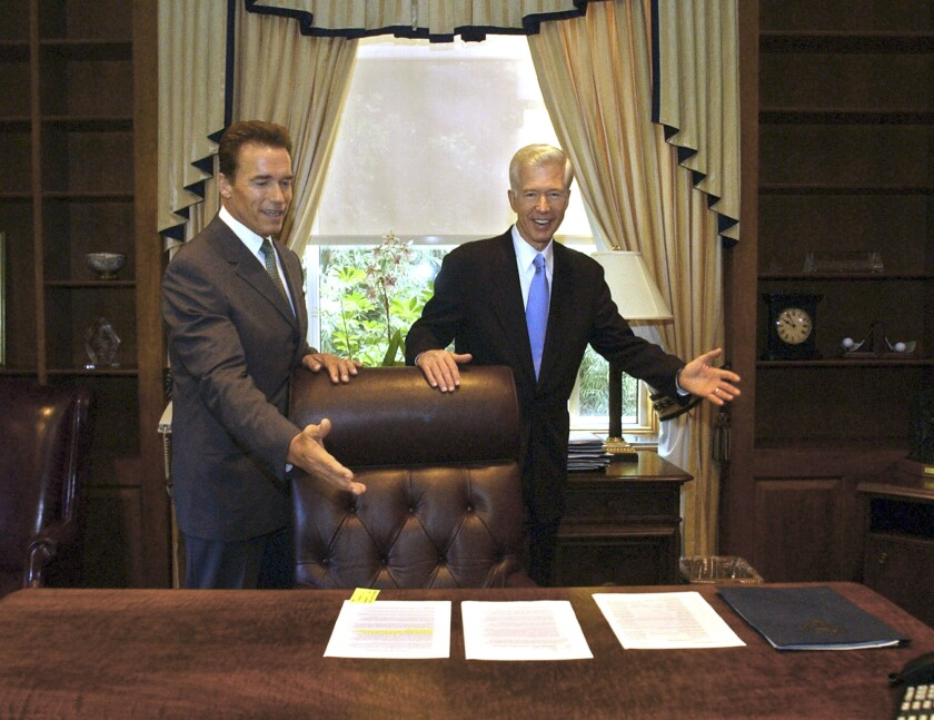 Gov.-elect Arnold Schwarzenegger, left, and Gov. Gray Davis meet at the governor's office at the Capitol.