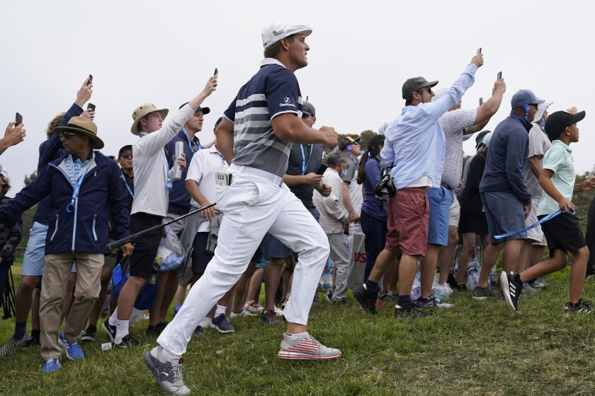 Bryson DeChambeau hurries to see his shot after hitting from the 11th fairway rough during the final round of the U.S. Open Golf Championship, Sunday, June 20, 2021, at Torrey Pines Golf Course in San Diego. (AP Photo/Marcio Jose Sanchez)