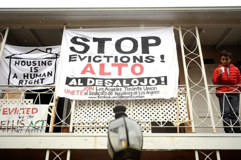 Anti-eviction signs decorate the Rodney Drive apartments in Los Feliz.